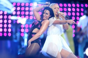 LOS ANGELES, CA - AUGUST 30: Recording artists Demi Lovato (L) and Iggy Azalea perform on the Pepsi Stage, during the 2015 MTV Video Music Awards, at The Orpheum Theatre on August 30, 2015 in Los Angeles, California. (Photo by Frederick M. Brown/Getty Images for MTV)